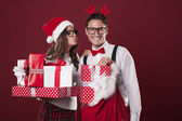 Loving couple with a lot of christmas gifts — Zdjęcie stockowe