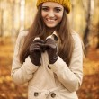 Smiling woman at autumn  — Stock Photo