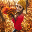 Happy woman have fun with leaves — Stock Photo