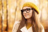 Beautiful woman wearing fashion glasses — Stock Photo