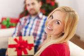 Couple celebrating christmas time  — Stock Photo