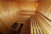 Interior of wooden and steaming sauna — Stock Photo