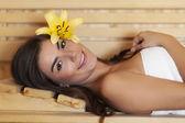 Beautiful woman lying down in sauna — Stock Photo