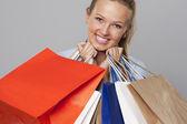 Smiling woman shopping bags — Stock Photo