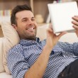 Man relaxing on sofa — Stock Photo #38142411