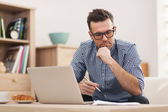 Busy man working at home — Stock Photo