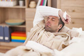 Sick man lying down — Stock Photo