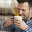 Man tasting coffee — Stock Photo