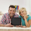 Couple showing screen of digital tablet — Stock Photo