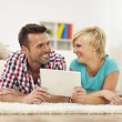 Couple with digital tablet — Stock Photo