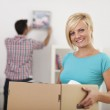 Woman moving home — Stock Photo #40609813