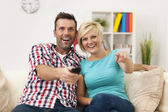 Couple watching funny movie — Stock Photo