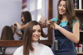 Cutting hair at the hairdresser — Stock Photo