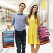 Couple walking in shopping mall — Stock Photo