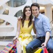 Couple sitting in shopping mall — Stock Photo #41987807