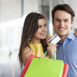 Couple with credit card — Stock Photo #41987943