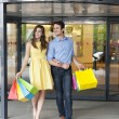 Couple leaving shopping mall — Stock Photo