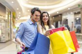 Couple looking at new clothes — Stock Photo