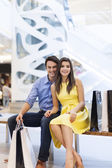 Smiling couple in shopping mall — Stock Photo