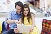 Couple looking on digital tablet — Stock Photo