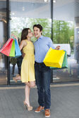 Woman thanking her boyfriend for shopping — Stock Photo