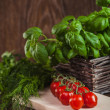 Herb and cherry tomatoes — Stock Photo