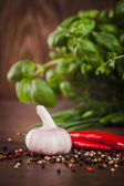 Garlic with pepper and herbs — Stock Photo