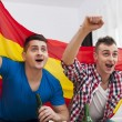 Men watching football match on TV — Stockfoto