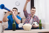 Young men supporting socce — Stock Photo