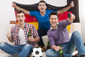 Men cheering football match — Stock Photo