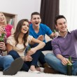 Friends watching funny movie — Stock Photo
