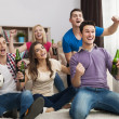 Friends enjoying soccer in TV — Stock Photo