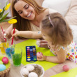 Mother and her baby painting easter eggs — Stock Photo