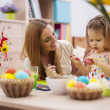 Mother and baby painting easter eggs — Stock Photo