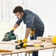 Carpenter cutting plank — Stock Photo #43803485