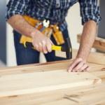 Man hitting nail by hammer — Stock Photo #43803583