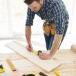 Carpenter checking dimensions — Stock Photo #43803935