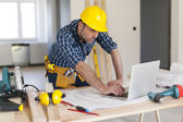 Hard working building contractor — Stock Photo