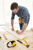 Carpenter checking dimensions — Stock Photo