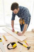 Carpenter checking dimensions — Stock Photo