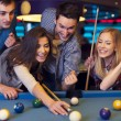 Friends on billiard — Stock Photo