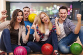Friends at the bowling alley — Stock Photo