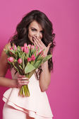 Woman with pink tulips — Stock Photo