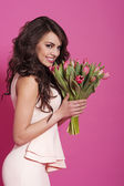 Woman with pink tulips — Foto Stock