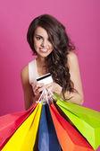 Mulher segurando sacolas de compras — Fotografia Stock