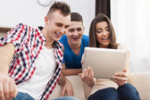 Friends with digital tablet — Stock Photo