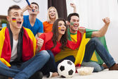 Friends supporting football team — Stok fotoğraf