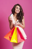 Elegant female shopaholic — Stock Photo