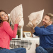 Couple having a pillow fight — Stock Photo #45778897