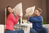 Couple having a pillow fight — Stock Photo